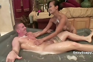 Cute oriental girl sucks locate and plays not far from soap with regard to the toilet