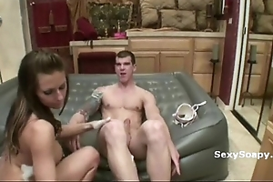 Freaky young floozie with teat piercing strips teases and puts soap on hard dick