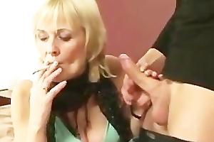 Horny smoking granny blowing cock