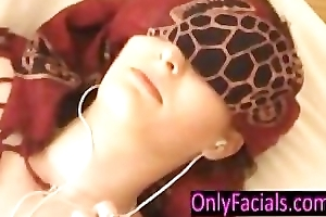 Blindfolded teen property facial