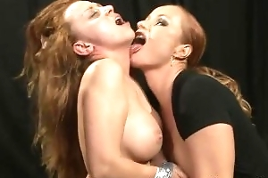 Busty lez domina bringing off with her slave