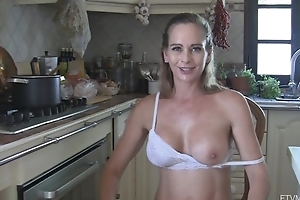 Juggy housewife disrobes and masturbates in the kitchen