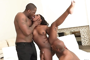 All-natural ebony gets both of her holes stuffed with gigantic cocks
