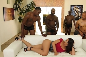 Young latin chick with pierced nipples enjoys interracial gangbang