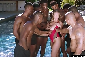 Esurient nympho with big natural tits enjoys interracial gangbang