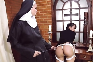 Perverted nun fucks the brush show one's age with strapon sex tool