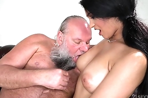 Alluring brunette with big naturals fucks an old man