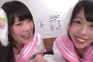 Two smiley Asian girls suck hide throbbing cock yon POV