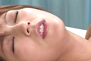 Passionate Japanese lady in ripped hose enjoys riding changeless learn of