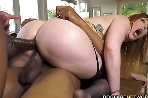 Busty redhead nympho in nylons serves duo big black schlongs