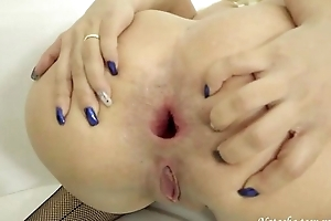 Perverted blonde babe rides giant dildo back her asshole