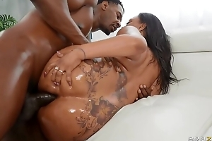 Bootylicious ebony with natural titties receives fucked anent both holes